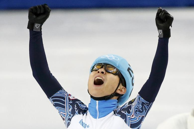 Victor An of Russia reacts as he wins the men's 1,000 metres short track speed skating final event at the Iceberg Skating Palace during the 2014 Sochi Winter Olympics February 15, 2014. REUTERS/Lucy Nicholson