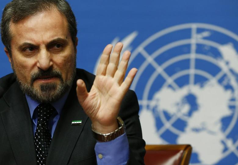 Louay Safi, spokesperson for the Syrian National Coalition, addresses a news conference at the United Nations European headquarters in Geneva February 14, 2014. REUTERS/Denis Balibouse