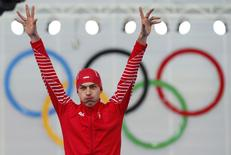 Winner Poland's Zbigniew Brodka celebrates on the podium during the flower ceremony for the men's 1,500 metres speed skating race in the Adler Arena at the Sochi 2014 Winter Olympic Games February 15, 2014. REUTERS/Marko Djurica