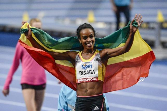 Genzebe Dibaba of Ethiopia celebrates after winning the women's 3000m during the XL Galan indoor track and field meet at the Stockholm Globe Arena, February 6, 2014. REUTERS/Janerik Henriksson/ TT News Agency