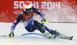 Bode Miller of the U.S. skis during the slalom run of the men's alpine skiing super combined event at the 2014 Sochi Winter Olympics at the Rosa Khutor Alpine Center February 14, 2014. REUTERS/Ruben Sprich