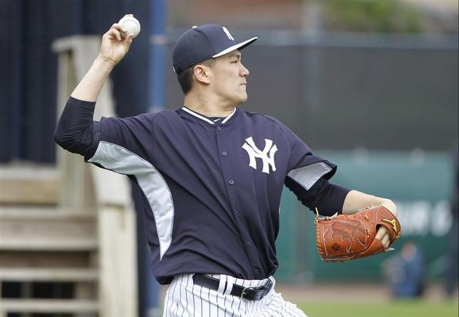 Feb 15, 2014; Tampa, FL, USA; New York Yankees starting pitcher Masahiro Tanaka (19) throws the ball during spring training at George M. Steinbrenner Field. Mandatory Credit: Kim Klement-USA TODAY Sports
