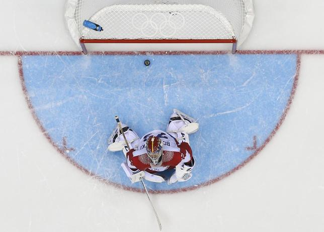 Russia's goalie Sergei Bobrovski reacts after giving up the game-winning goal to Team USA's T.J. Oshie (not seen) during a shootout in their men's preliminary round ice hockey game at the Sochi 2014 Winter Olympic Games February 15, 2014. REUTERS/Mark Blinch