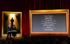Actor Chris Hemsworth (L) and Academy of Motion Picture Arts and Sciences President Cheryl Boone Isaacs announce the nominees for Best Animated Feature at the 86th Academy Awards nominee announcements in Beverly Hills, California January 16, 2014. REUTERS/Phil McCarten