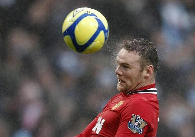 Manchester United's Wayne Rooney heads to score his second goal against Manchester City during their FA Cup soccer match at the Etihad Stadium in Manchester, northern England, January 8, 2012. REUTERS/Phil Noble