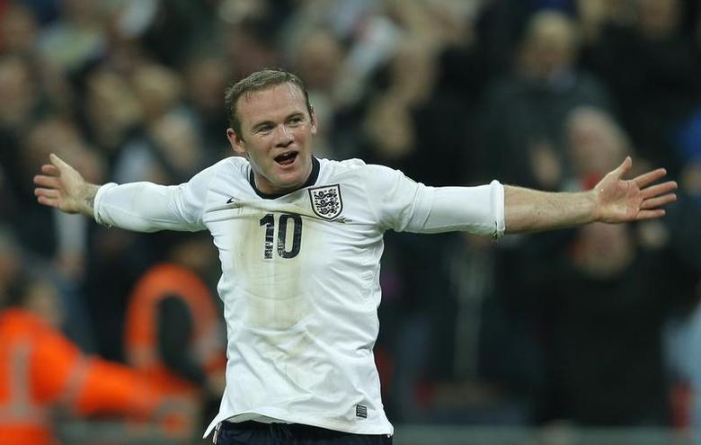 England's Wayne Rooney celebrates after scoring during their 2014 World Cup qualifying soccer match against Poland at Wembley Stadium in London October 15, 2013. REUTERS/Eddie Keogh