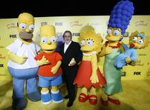 Matt Groening (C), creator of The Simpsons, poses with characters from the show (L-R) Homer, Bart, Lisa, Marge and Maggie at the 20th anniversary party for the television series at Barker hangar in Santa Monica, California October 18, 2009. REUTERS/Mario Anzuoni