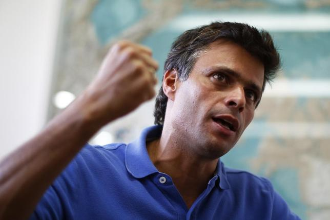 Venezuelan opposition leader Leopoldo Lopez gestures while speaking during an interview with Reuters in Caracas, February 11, 2014. REUTERS/Jorge Silva