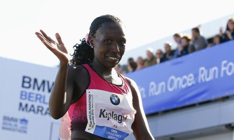 Florence Kiplagat of Kenya reacts after winning the 40th Berlin marathon, September 29, 2013. REUTERS/Tobias Schwarz