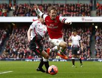 Arsenal's Nacho Monreal (R) is fouled by Liverpool's Jon Flanagan during their English FA Cup fifth round soccer match at the Emirates stadium in London February 16, 2014. REUTERS/Darren Staples