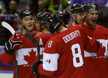 Canada's Drew Doughty (8) celebrates his game winning overtime goal against Finland with teammates during their men's preliminary round ice hockey game at the Sochi 2014 Winter Olympic Games February 16, 2014. REUTERS/Jim Young