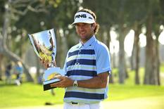 February 16, 2014; Pacific Palisades, CA, USA; Bubba Watson poses with the winners trophy following his victory of the Northern Trust Open at Riviera Country Club. Gary A. Vasquez-USA TODAY Sports