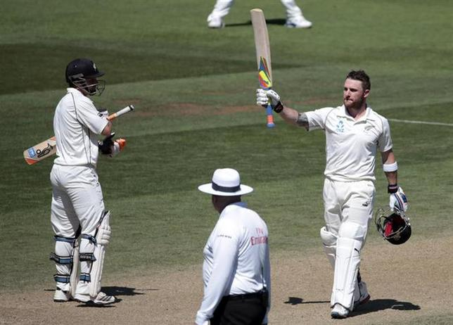 New Zealand's Brendon McCullum (R) acknowledges his 200 against India during the second innings on day four of the second international test cricket match at the Basin Reserve in Wellington, February 17, 2014. REUTERS/Anthony Phelps