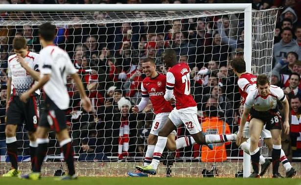 Arsenal's Lukas Podolski (3rd L) celebrates his goal against Liverpool with team mate Yaya Sanogo during their FA Cup fifth round soccer match at the Emirates Stadium in London, February 16, 2014. REUTERS/Darren Staples