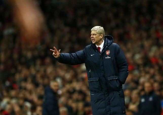 Arsenal manager Arsene Wenger gestures during their English Premier League soccer match against Crystal Palace at the Emirates stadium in London, February 2, 2014. REUTERS/Eddie Keogh