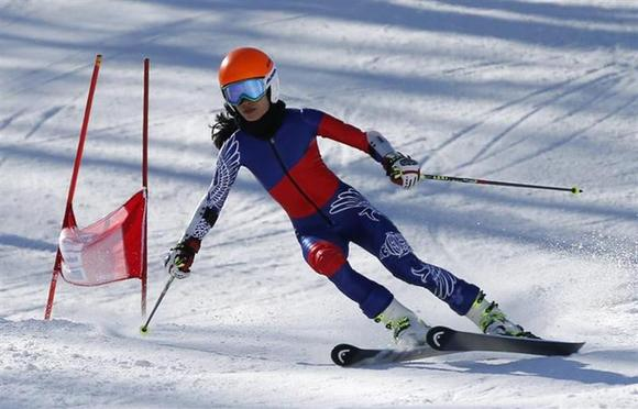 Violinist Vanessa-Mae Vanakorn, who is representing Thailand, clears a gate during free practice in the 2014 Sochi Winter Olympics at the Rosa Khutor Alpine Center February 13, 2014. Mae will be competing in the women's alpine skiing giant slalom race. REUTERS/Mike Segar