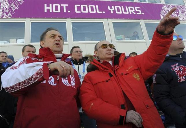 Russian President Vladimir Putin (C) and Sports Minister Vitali Mutko (L) watch the cross country skiing men's relay during the Sochi 2014 Olympic Winter Games at Laura Cross-Country Ski and Biathlon Center near Krasnaya Polyana February 16, 2014. REUTERS/Mikhail Klimentyev/RIA Novosti/Kremlin