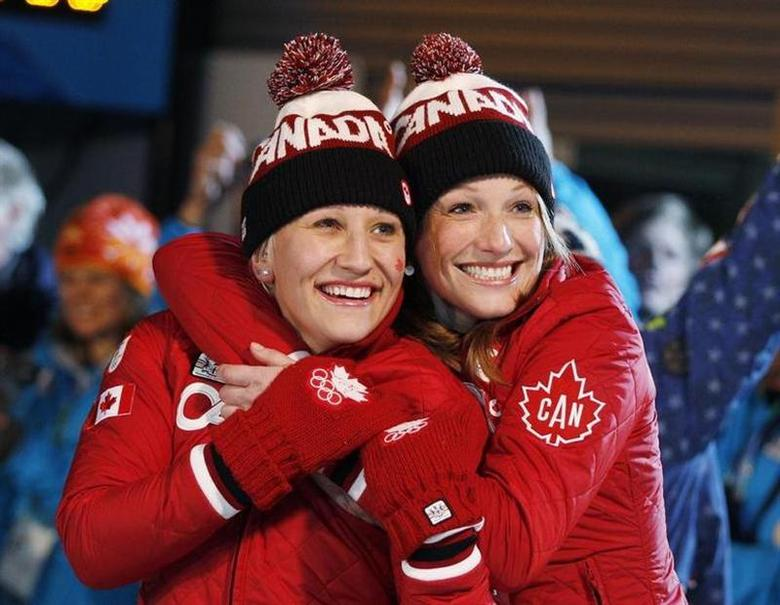 Gold medalists Kaillie Humphries (L) and Heather Moyse of Canada celebrate after the final of women's bobsleigh at the Vancouver 2010 Winter Olympics in Whistler, British Columbia, in this February 24, 2010 file photo. REUTERS/Tony Gentile