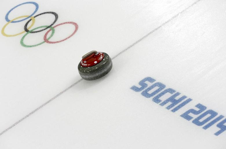 A stone is seen during a women's curling round robin game at the 2014 Sochi Winter Olympics at the Ice Cube Curling Center February 17, 2014. REUTERS/Ints Kalnins