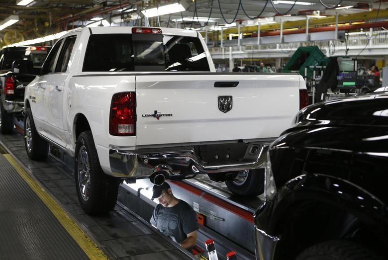 Chrysler Group assembly staff works below a 2014 Dodge Ram pickup truck at the Warren Assembly Plant in Warren, Michigan December 11, 2013. REUTERS/Rebecca Cook