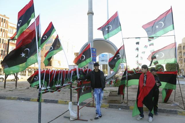 Men sell Libyan flags as they mark the third anniversary of the February 17 uprising against Muammar Gaddafi in Benghazi, February 16, 2014. REUTERS/Esam Omran Al-Fetori