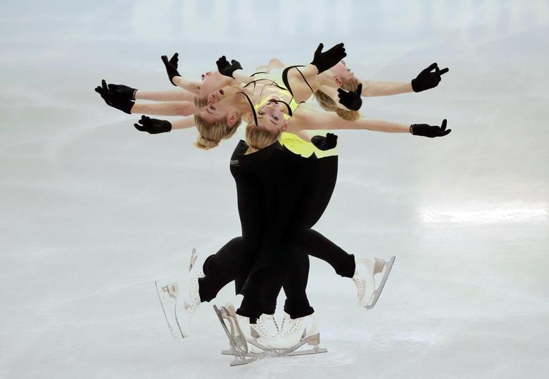 Gracie Gold of the U.S. practises her routine during a figure skating training session at the Iceberg Skating Palace training arena during the 2014 Sochi Winter Olympics February 17, 2014. REUTERS/Lucy Nicholson