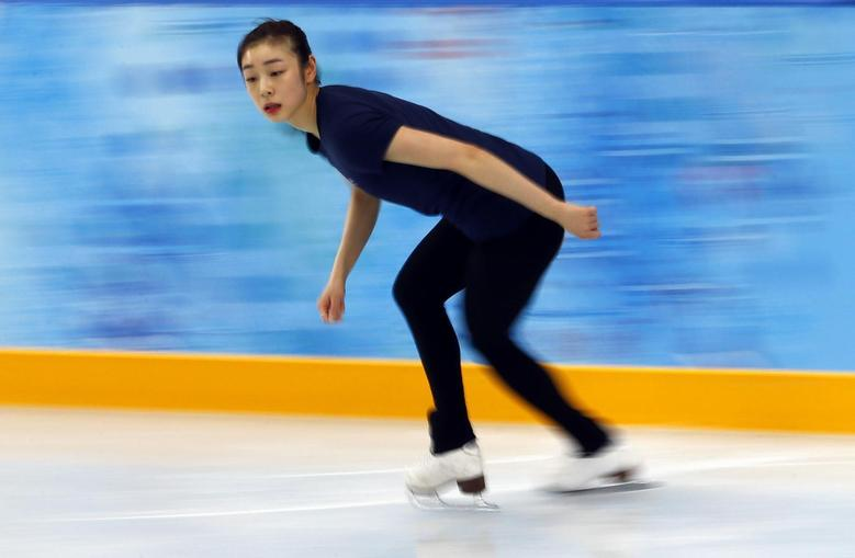 South Korea's Kim Yuna practices her routine during a figure skating training session at the Iceberg Skating Palace training arena during the 2014 Sochi Winter Olympics February 17, 2014. REUTERS/David Gray