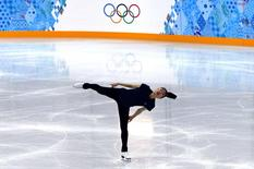 South Korea's Kim Yuna practises her routine during a figure skating training session at the Iceberg Skating Palace training arena during the 2014 Sochi Winter Olympics February 17, 2014. REUTERS/David Gray