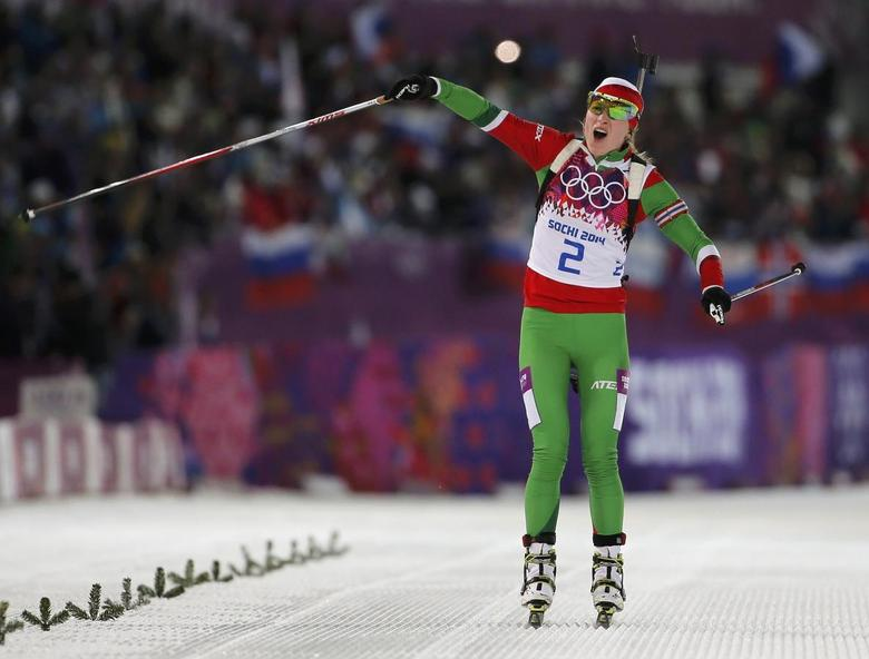 Darya Domracheva of Belarus celebrates as she approaches the finish line to win the women's biathlon 12.5km mass start event at the Sochi 2014 Winter Olympic Games in Rosa Khutor February 17, 2014. REUTERS/Stefan Wermuth
