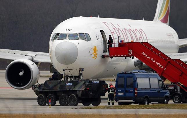A police vehicle guards in front of the hijacked Ethiopian Airlines flight ET 702 after passengers disembarked at Cointrin Airport in Geneva February 17, 2014. REUTERS/Denis Balibouse