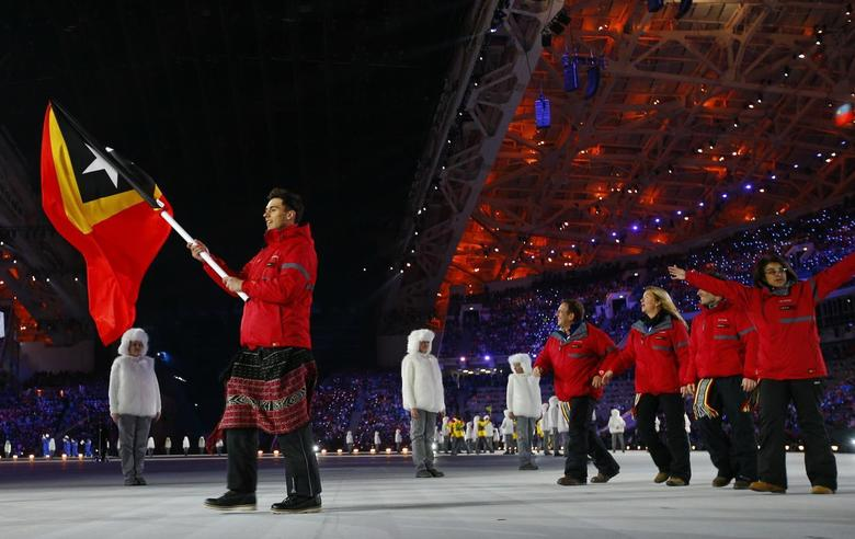 Flag-bearer Yohan Goncalves of Democratic Republic of Timor-Leste leads his country's delegation during the opening ceremony of the 2014 Sochi Winter Olympic Games at Fisht stadium February 7, 2014. REUTERS/Brian Snyder