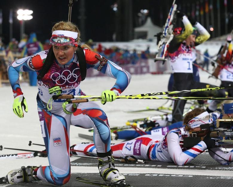 Czech Republic's Gabriela Soukalova leaves the shooting range during the women's biathlon 12.5 km mass start event at the 2014 Sochi Winter Olympics February 17, 2014. REUTERS/Sergei Karpukhin