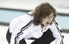 Switzerland's skip Mirjam Ott shouts to teammates during their women's curling round robin game against China at the Ice Cube Curling Center during the 2014 Sochi Winter Olympic Games February 17, 2014. REUTERS/Ints Kalnins