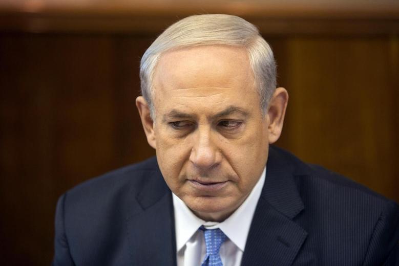 Israel's Prime Minister Benjamin Netanyahu attends the weekly cabinet meeting in Jerusalem February 9, 2014. REUTERS/Sebastian Scheiner/Pool