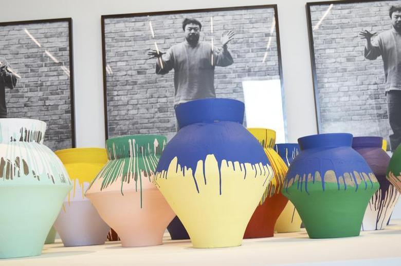 Chinese artist Ai Weiwei's ''Colored Vases'' are shown at the Perez Art Museum Miami, Florida in this December 3, 2013 photo. REUTERS/Zachary Fagenson