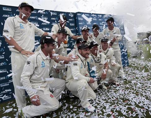 New Zealand's cricketers pose for a team photo after winning the Test series against India after drawing the second international test cricket match at the Basin Reserve in Wellington, February 18, 2014. REUTERS/Anthony Phelps