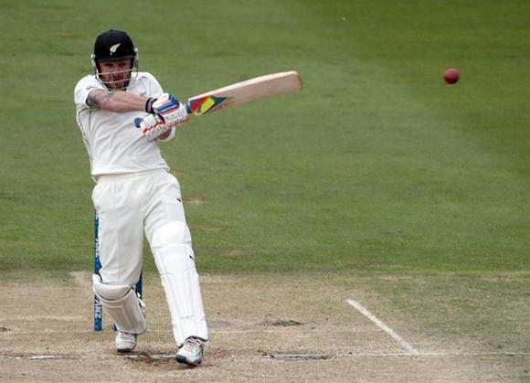 New Zealand's Brendon McCullum plays a shot against India during the second innings of play on day five of the second international test cricket match at the Basin Reserve in Wellington, February 18, 2014. REUTERS/Anthony Phelps