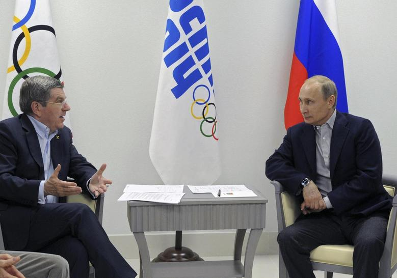 Russia's President Vladimir Putin (R) meets with International Olympic Committee (IOC) President Thomas Bach during the Sochi 2014 Winter Olympic Games February 15, 2014. REUTERS/Mikhail Klimentyev/RIA Novosti/Kremlin