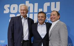 National Hockey League Players' Association (NHLPA) Executive Director Donald Fehr, International Ice Hockey Federation (IIHF) President Rene Fasel and National Hockey League (NHL) Commissioner Gary Bettman (L-R) pose for a picture after a joint news conference at the 2014 Sochi Winter Olympics, February 18, 2014. REUTERS/Jim Young