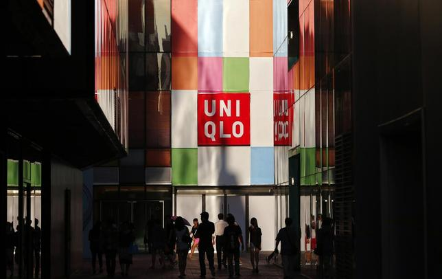 People stand outside a UNIQLO shop in Beijing, August 24, 2013. REUTERS/Petar Kujundzic