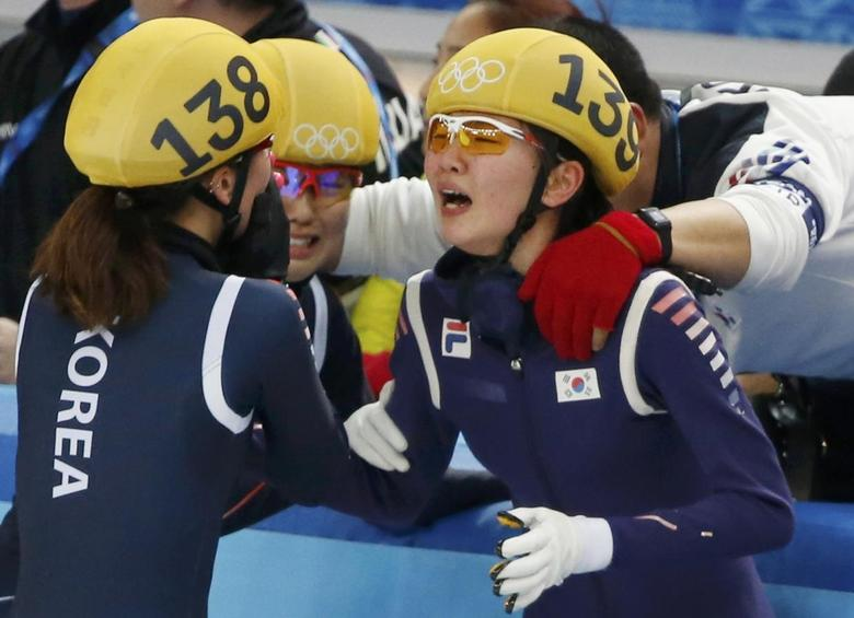 South Korea's Shim Suk Hee (R) reacts with Park Seung-Hi (L) after their team won the women's 3,000 metres relay final event at the Iceberg Skating Palace during the 2014 Sochi Winter Olympics February 18, 2014. REUTERS/Lucy Nicholson