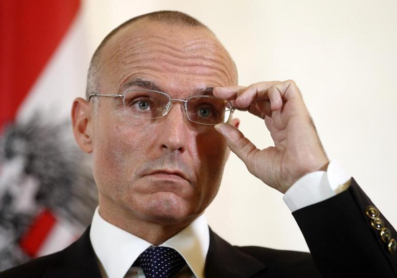 Austria's Defence Minister Gerald Klug adjusts his glasses during a news conference in Vienna June 6, 2013. REUTERS/Heinz-Peter Bader