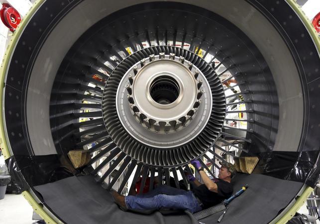 General Electric employee Jim Jones assembles a GE90 engine at the GE Aviation Peebles Test Operations Facility in Peebles, Ohio, November 15, 2013. REUTERS/Matt Sullivan
