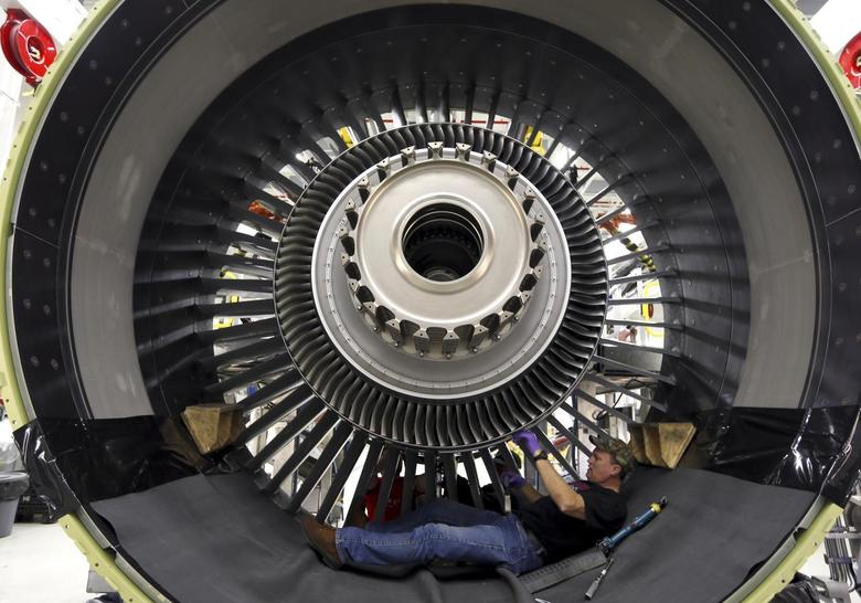 General Electric employee Jim Jones assembles a GE90 engine at the GE Aviation Peebles Test Operations Facility in Peebles, Ohio, November 15, 2013. REUTERS/Matt Sullivan