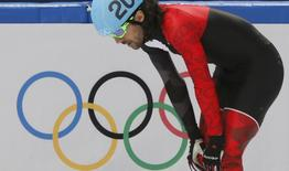 Canada's Charles Hamelin reacts after crashing out in the men's 500 metres short track heat event at the Iceberg Skating Palace during the 2014 Sochi Winter Olympics February 18, 2014. REUTERS/Alexander Demianchuk