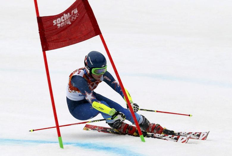 Mikaela Shiffrin of the U.S. clears a gate during the second run of the women's alpine skiing giant slalom event at the 2014 Sochi Winter Olympics at the Rosa Khutor Alpine Center February 18, 2014. REUTERS/Stefano Rellandini