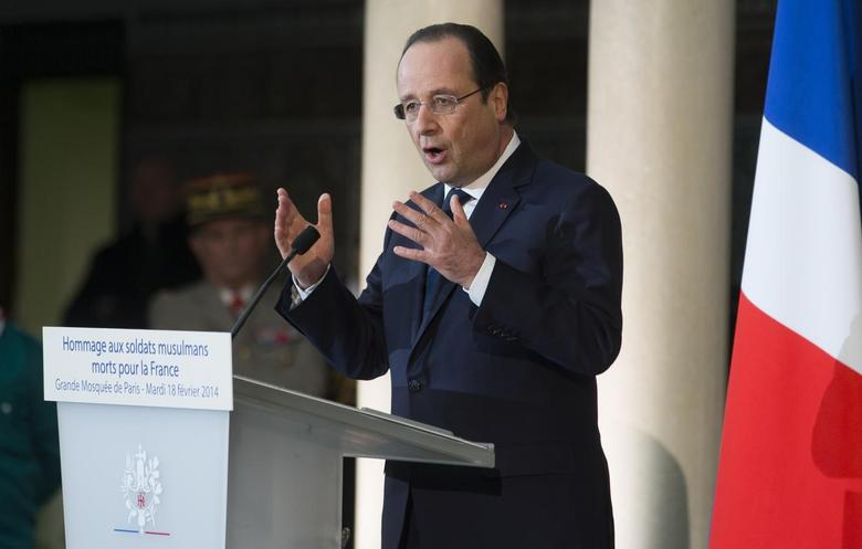 French President Francois Hollande delivers a speech at the Grand Mosque of Paris after a ceremony to inaugurate the memorial of the Muslim soldiers, who died fighting for France February 18, 2014. REUTERS/Ian Langsdon/Pool
