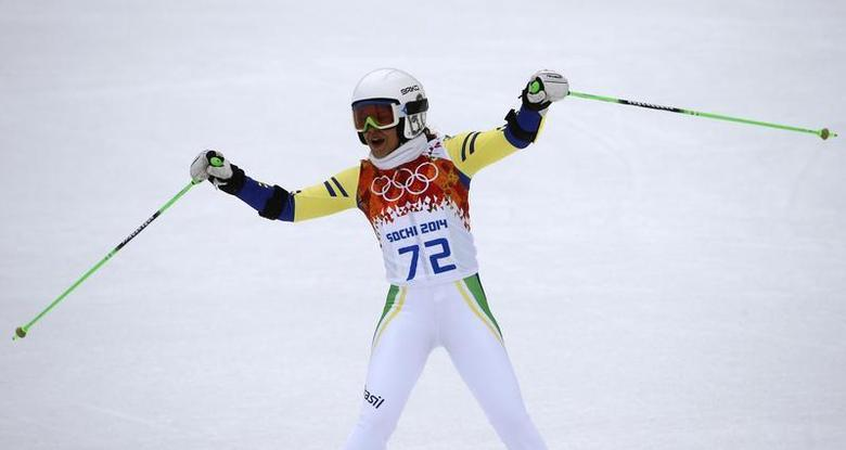 Brazil's Maya Harrisson reacts in the finish area after competing in the first run of the women's alpine skiing giant slalom event during the 2014 Sochi Winter Olympics at the Rosa Khutor Alpine Center February 18, 2014. REUTERS/Leonhard Foeger