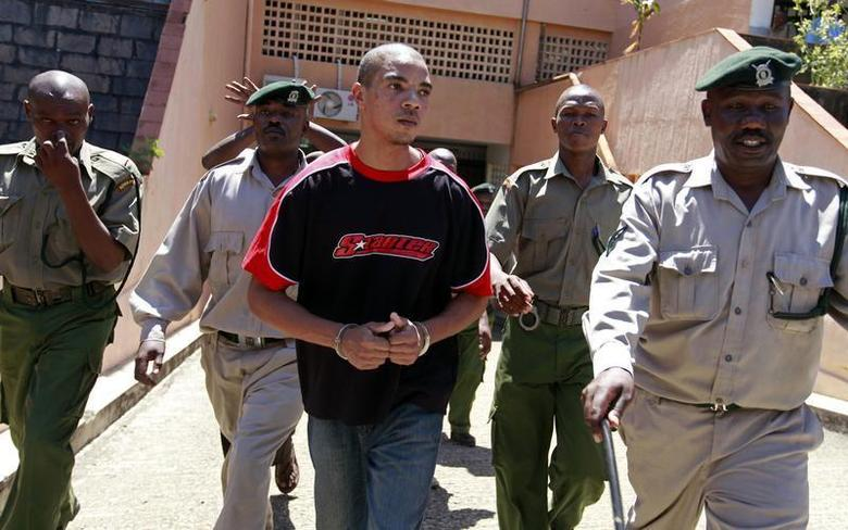 British citizen Jermaine Grant (C) is escorted into court for a hearing in the Kenyan coastal town of Mombasa May 9, 2012. REUTERS/Joseph Okanga
