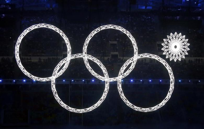 One of the five Olympic Rings fails to open during the opening ceremony of the 2014 Sochi Winter Olympics, February 7, 2014. Russia's first Winter Olympics struggled with some teething problems and a dedicated Twitter account registering the hiccups quickly racked up followers. REUTERS/Lucy Nicholson